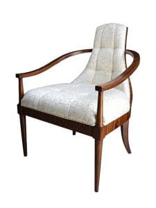 Accent Chairs - A Rosewood Occasional Armchair, The Scoop Toprail Intersected By A Tapered Padded Back With Shallow Buttoning, The Upholstered Seat On Turned Legs. The Original Art Deco. Made by Theodore Alexander.