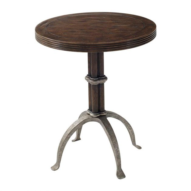 L'Usine Accent Table. A Byron mahogany lamp table, the circular reeded edge top above a cluster column and four iron outswept legs. Inspired by a 19th century original.