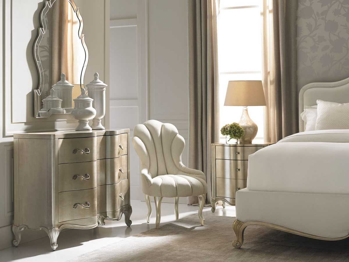 "Caracole Classic Collection Items in picture: ""Night And Day"" Bed, ""You Are The One"" Nightstand, ""Smile Lines"" Accent Chair, ""Best Case Scenario"" Chest of Drawers and ""Who's The Fairest One Of All?"" Mirror"