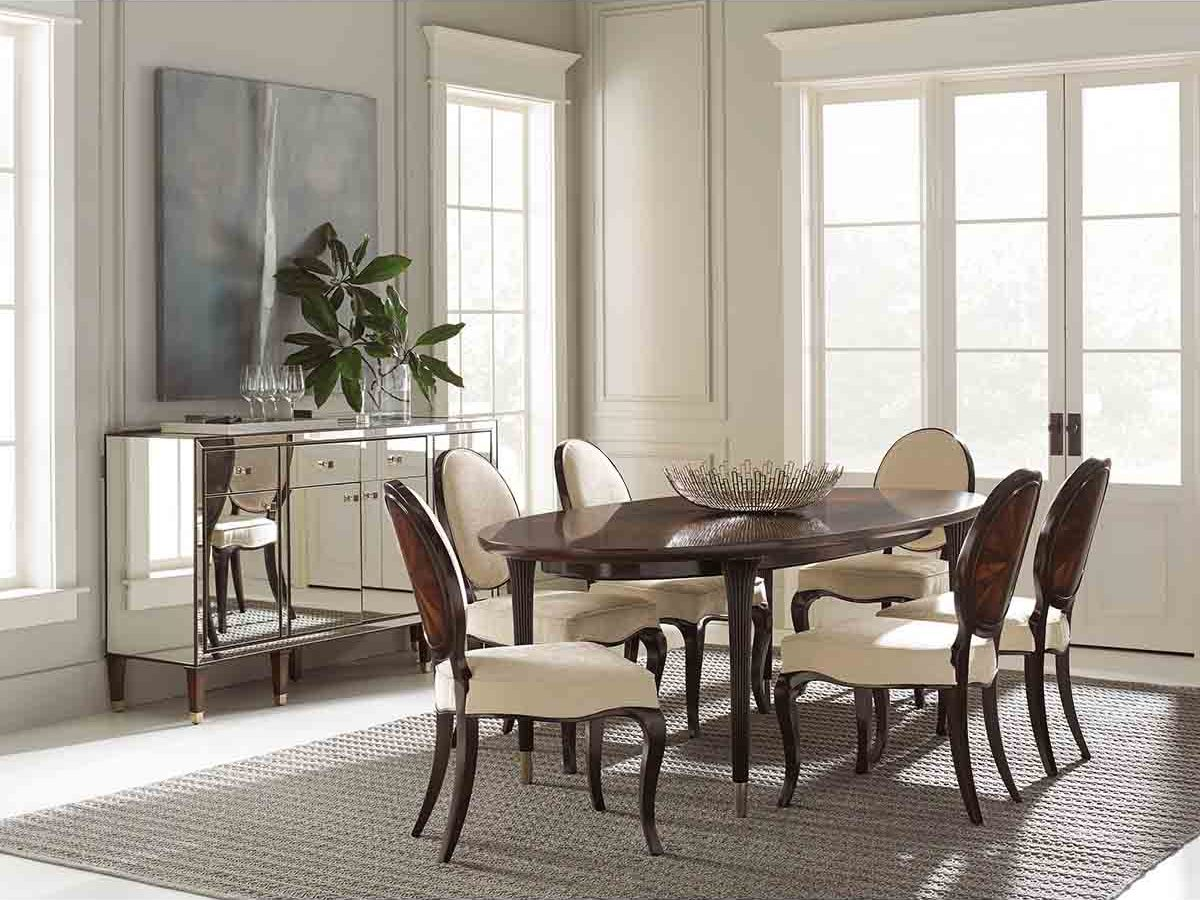 "Caracole Classic Collection - Contemporary Furniture Available at Place Direct - Items in picture: ""Dinner Invitation"" Dining Table, ""Ladies Choice"" Dining Chairs and ""A New Reflection of You"" Sideboard"